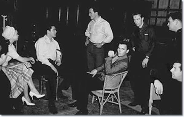 Lamar Fike, Juliet Prowse, Elvis Presley, Pat Boone (standing), Sonny West (looking at the camera), Gene Smith (standing behind Sonny), Alan Fortas (standing far right), and Joe Esposito (sitting far right).