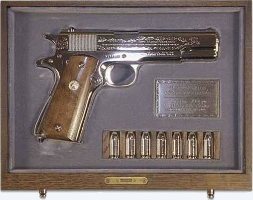 As indicated in his letter, Elvis presented Nixon with a gift. This was a commemorative World War II Colt 45 pistol in a wooden chest.