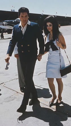 'Elvis Presley with his wife Priscilla Presley at an airport during their honeymoon journey from Las Vegas, Nevada to Palm Springs, California in May 1967'.