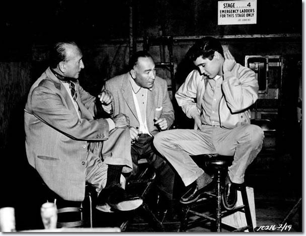Michael Curtiz, Hal Wallis and Elvis Presley on the set of King Creole.
